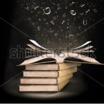 stock-photo-an-open-book-with-letters-falling-into-the-pages-96506812